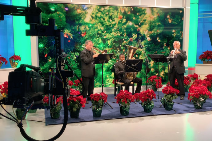 Photo of TXWES brass trio performing as part of CBS 11 Christmas morning special