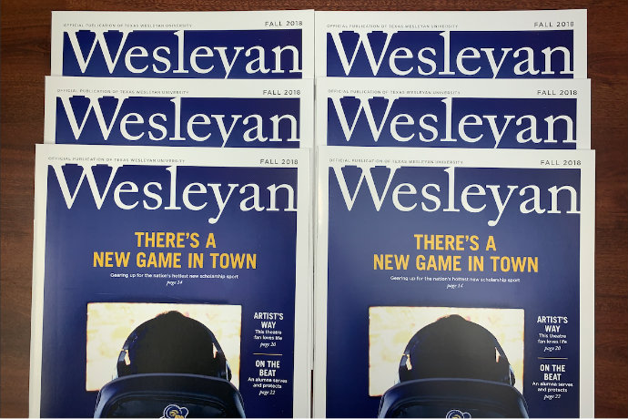 Photo of several copies of the fall 2018 issue of Wesleyan magazine.