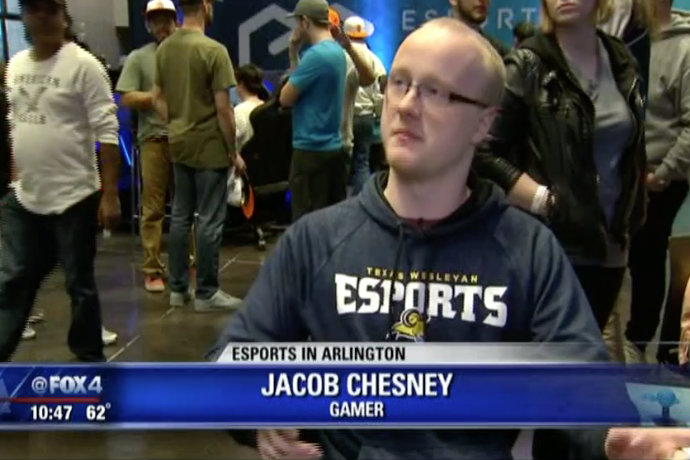 Photo of TXWES student and esports athlete Jacob Chesney being interviewed by Fox 4 during the grand opening of the city of Arlington's new esports stadium.