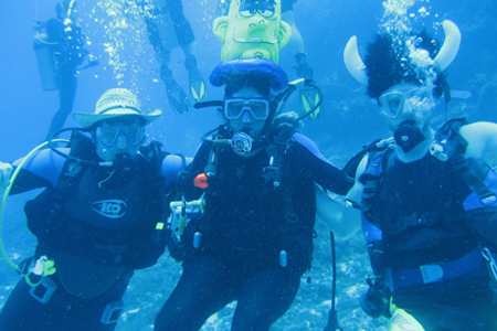 photo of three underwater divers
