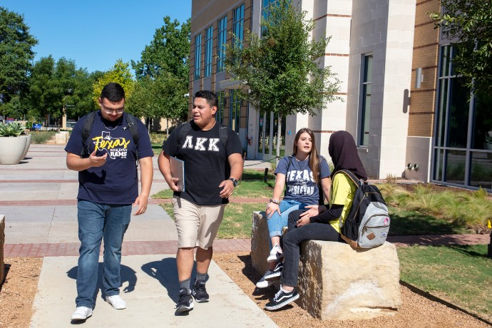 Photo of students walking outside Martin Center.