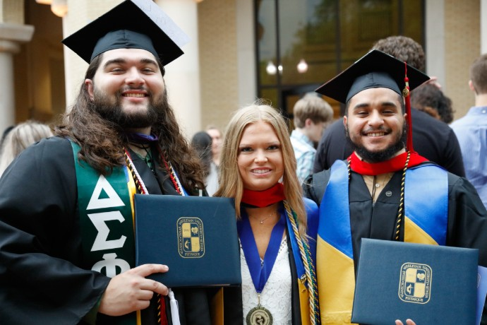Photo of three Texas Wesleyan graduates from Spring 2019 Commencement.
