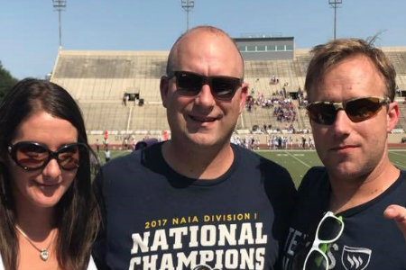 Photo of Texas Wesleyan alumni at a football game in Fort Worth