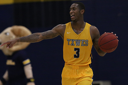 Branden Jenkins playing basketball for Texas Wesleyan