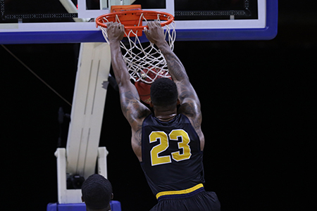 Najeal Young slams one home in an NAIA Quarterfinal contest against Dalton State College.
