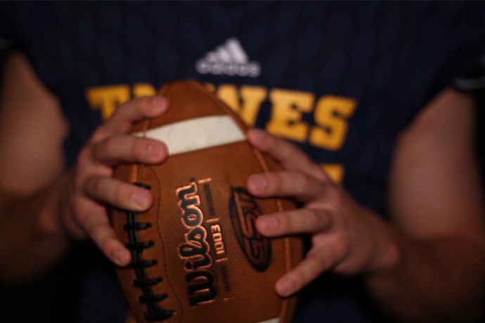 Picture is of a football held by a TXWES football player
