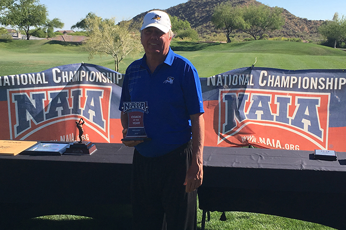 Photo of TXWES men's golf Head Coach Bobby Cornett with his 2019 Coach of the Year trophy.