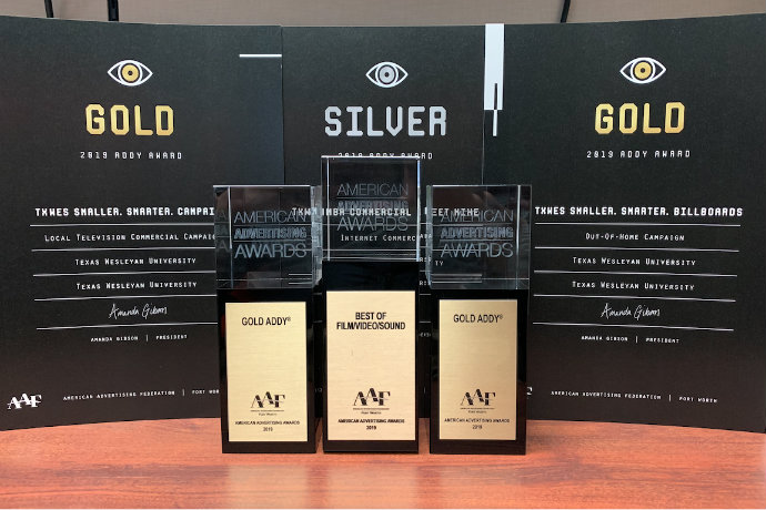 Photo of gold, silver and best in show awards that Texas Wesleyan received at the 2019 AAF Addy awards in Fort Worth.
