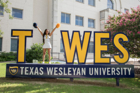 Student on TXWES Selfie Station Sign