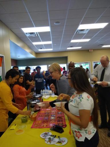Students, staff, and faculty move around Lou's Place to discover delicious food and experience different cultures at this year's Asian Pacific and Islander American Heritage Month celebration.
