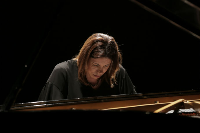 Photo of TXWES music professor Ilka Araujo performing a piano recital in Brazil