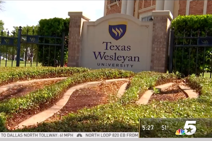 Photo of the TXWES logo at the corner of Rosedale and Wesleyan Streets, as part of NBC 5's story on the Rosedale Renaissance.