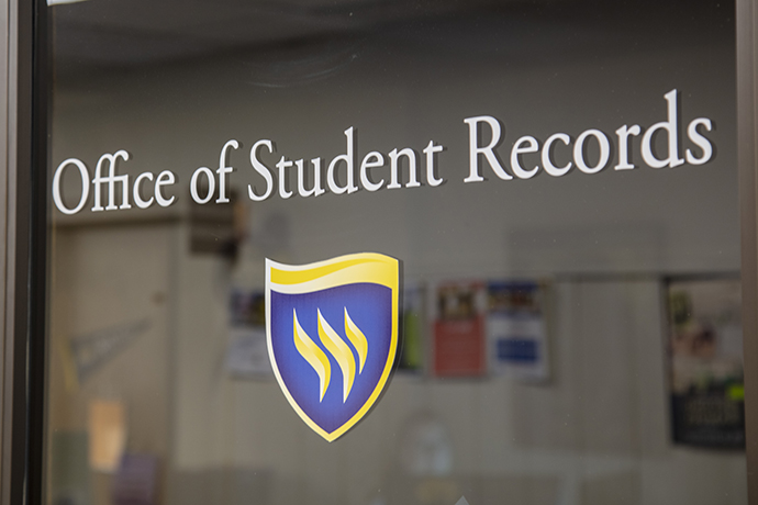 The Office of Student Records door sign.