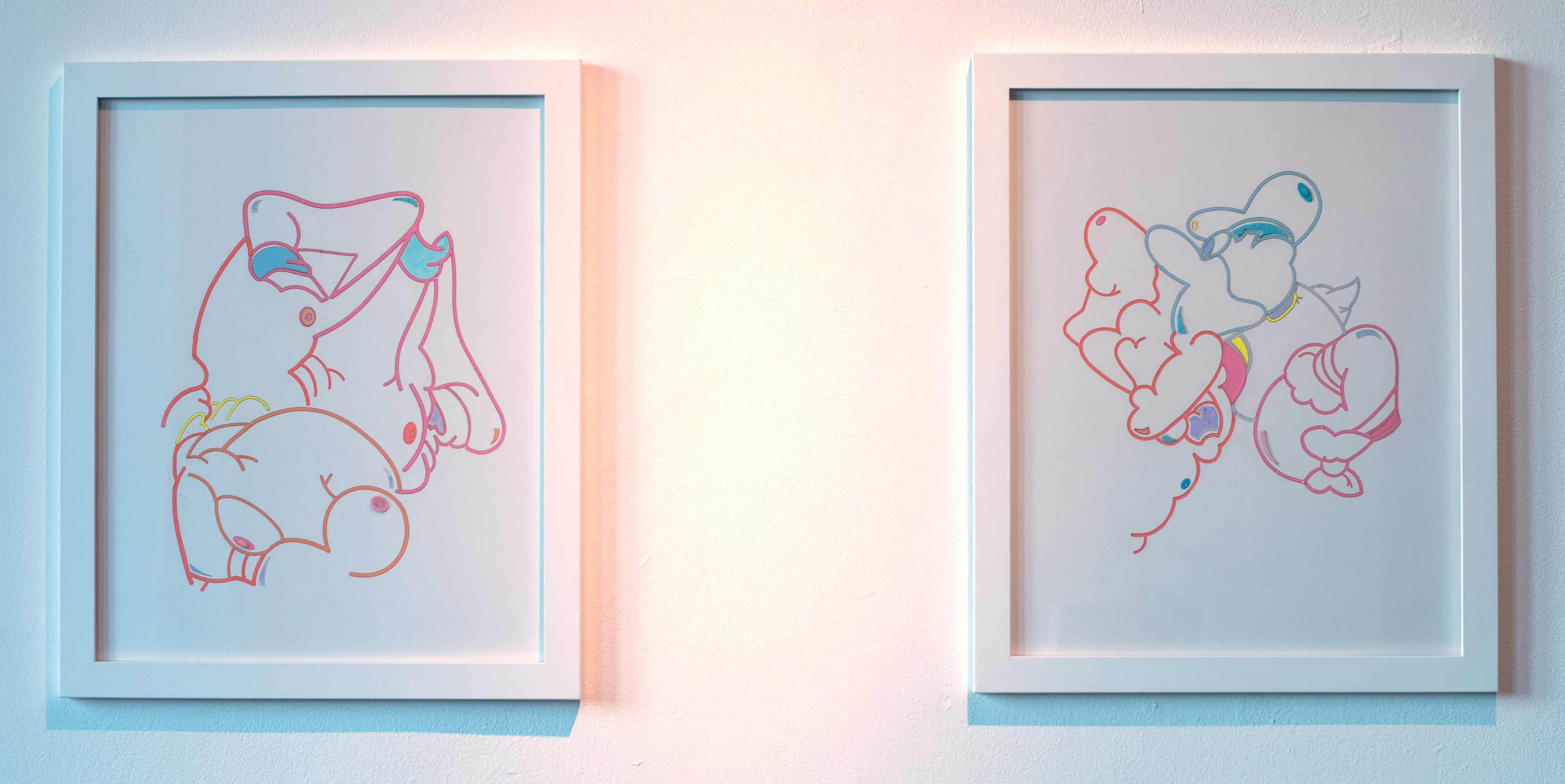 Two small wall pieces, abstract line drawings.