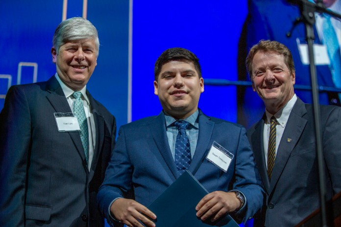 Photo of Thomas H. Law Scholarship recipient Stuart Tennyson, TXWES President Fred Slabach and Thomas H. Law, Jr.