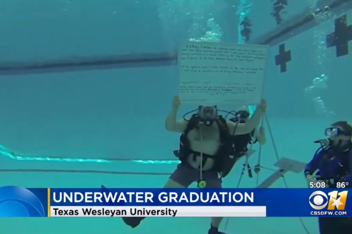Photo of CBS 11's underwater graduation coverage
