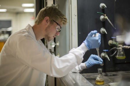Texas Wesleyan chemistry student conducts an experiment in the laboratory.