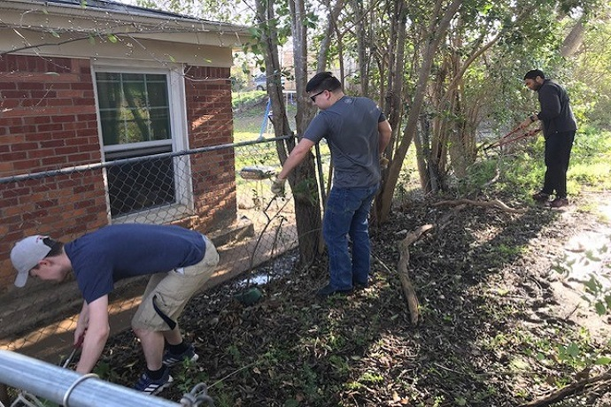 Hatton W. Sumners Scholars clean up the yard of a homebound senior in Fort Worth. N. Davis, S. Tennyson, B. Dozier. March 2019