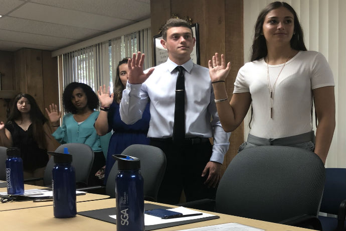 Students being sworn in to office with SGA