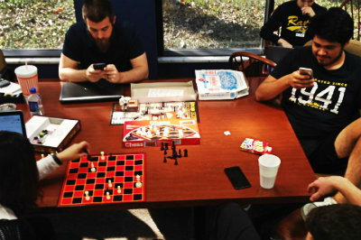 four students playing board games