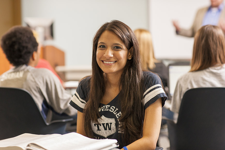 Admissions - Aid - Graduate - Counseling - Masters Degrees in Counseling - What will it cost? - female student smiling