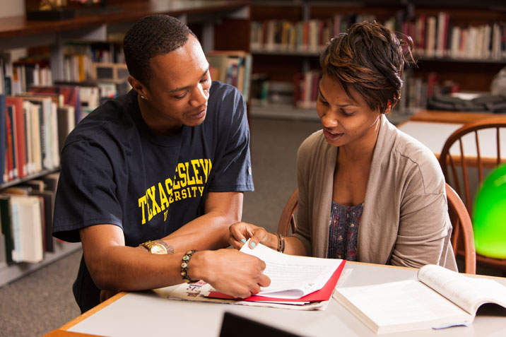 Students study together in the West Library.