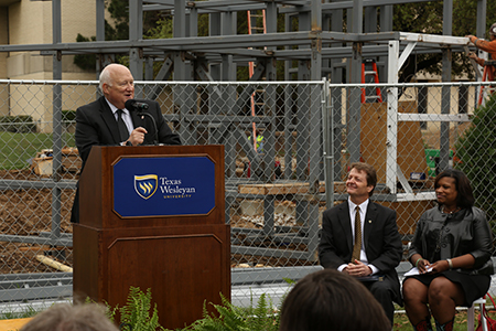 Bishop Mike Lowry address the crowd during the April 2015 Texas Wesleyan University clock tower topping out ceremony.