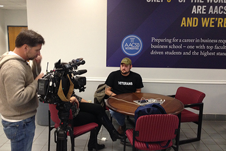 Texas Wesleyan University senior business major interviews with WFAA about project he completed with RadioShack.