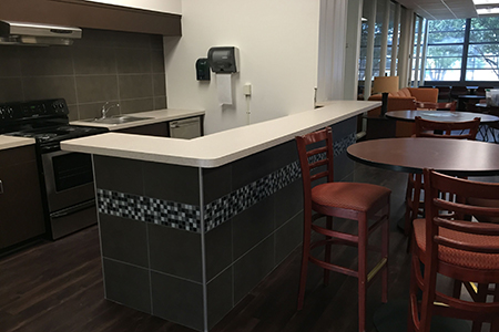 The kitchen in the Stella common area got a full redo with new appliances, cabinets, flooring and a stone front.