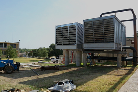 On the left is Texas Wesleyan University's new cooling tower, next to the existing cooling tower. Both cooling towers will support the new energy-saving power plant.