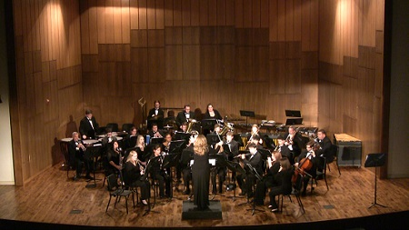The wind ensemble performs a concert