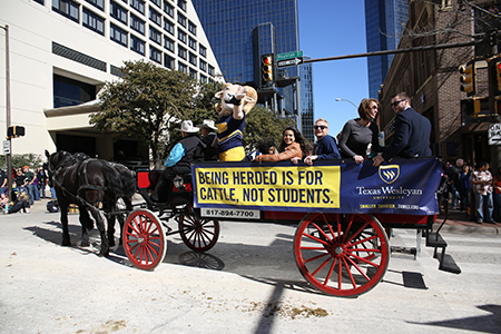 To kick of the Fort Worth Stock Show and Rodeo, organizers held an All-Western Parade on Sat., Jan. 17. Texas Wesleyan students participated in the parade through downtown Fort Worth.