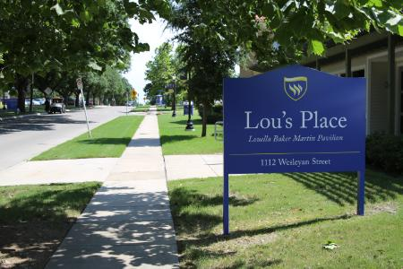 New campus sign in front of Lou's Place.