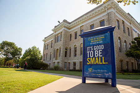 A sign in front of the Oneal-Sells Administration building proudly announces that Texas Wesleyan has been ranked in the top tier of regional universities in the West by U.S. News and World Report for the sixth consecutive year.