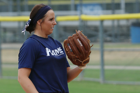 student pitching in softball game