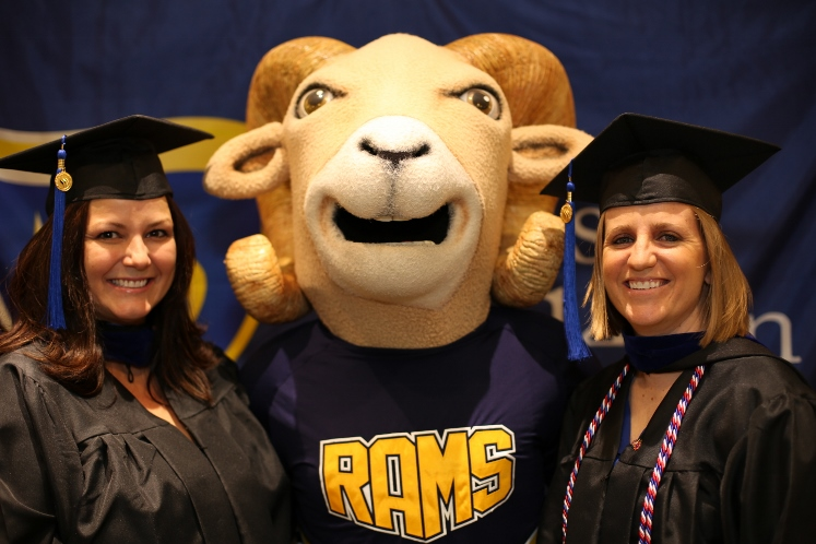 Commencement Photo of students with mascot