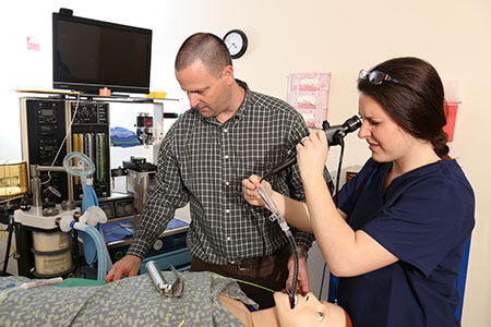 Assistant Professor of Nurse Anesthesia William Johnson teaching a lesson in the simulation lab.