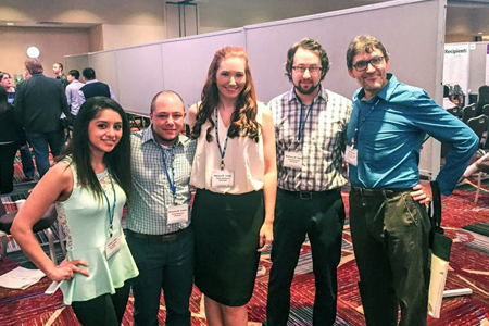 Ashley Lopez, Phoenix Carlini, Alyssa Jones, Dr. Matt Hand and Dr. Jay Brown gather while presenting research at the annual Association for Psychological Sciences convention.