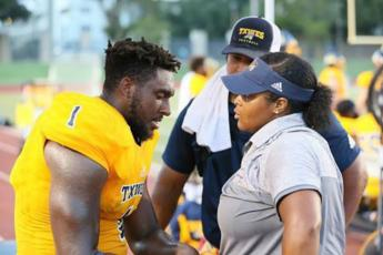 Photo of football Athletic Trainer Dominique Brown during a TXWES football game.