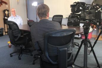 Photo of criminal justice Professor Cary Adkinson speaking with WFAA on the case of accused killer Ada Bilbrey.