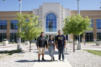Photo of students posing in front of the Nick & Lou Martin University Center.